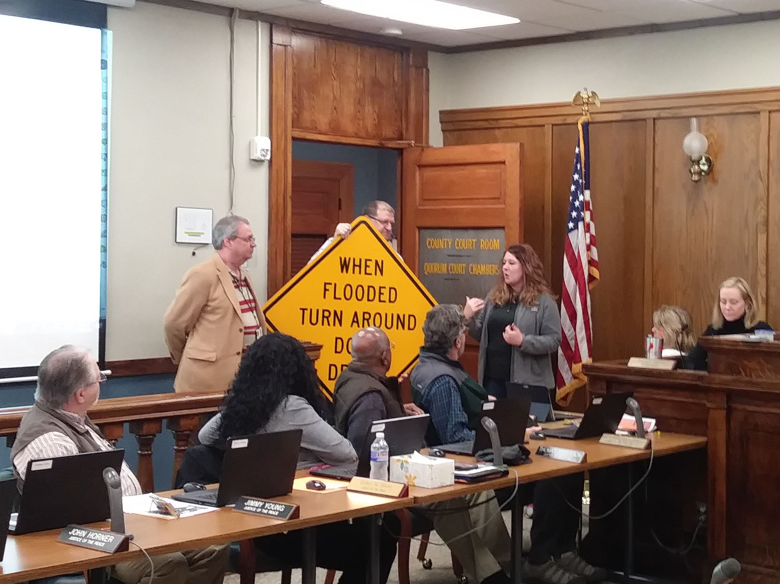 Tabita Clarke presents TADD Signs to Garland County.